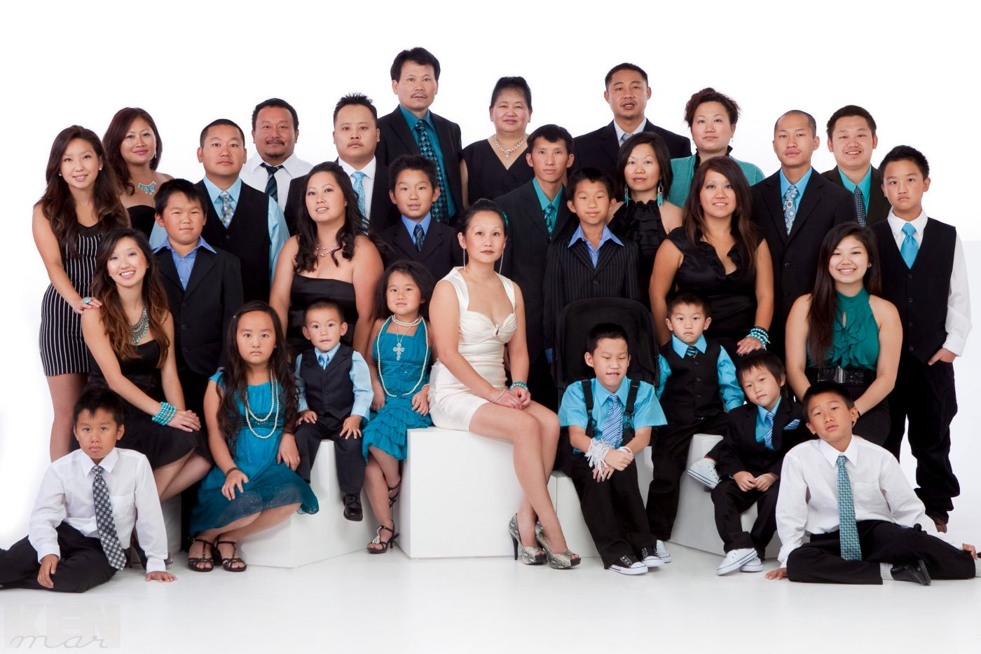 A family of 30 poses comfortably against a white background