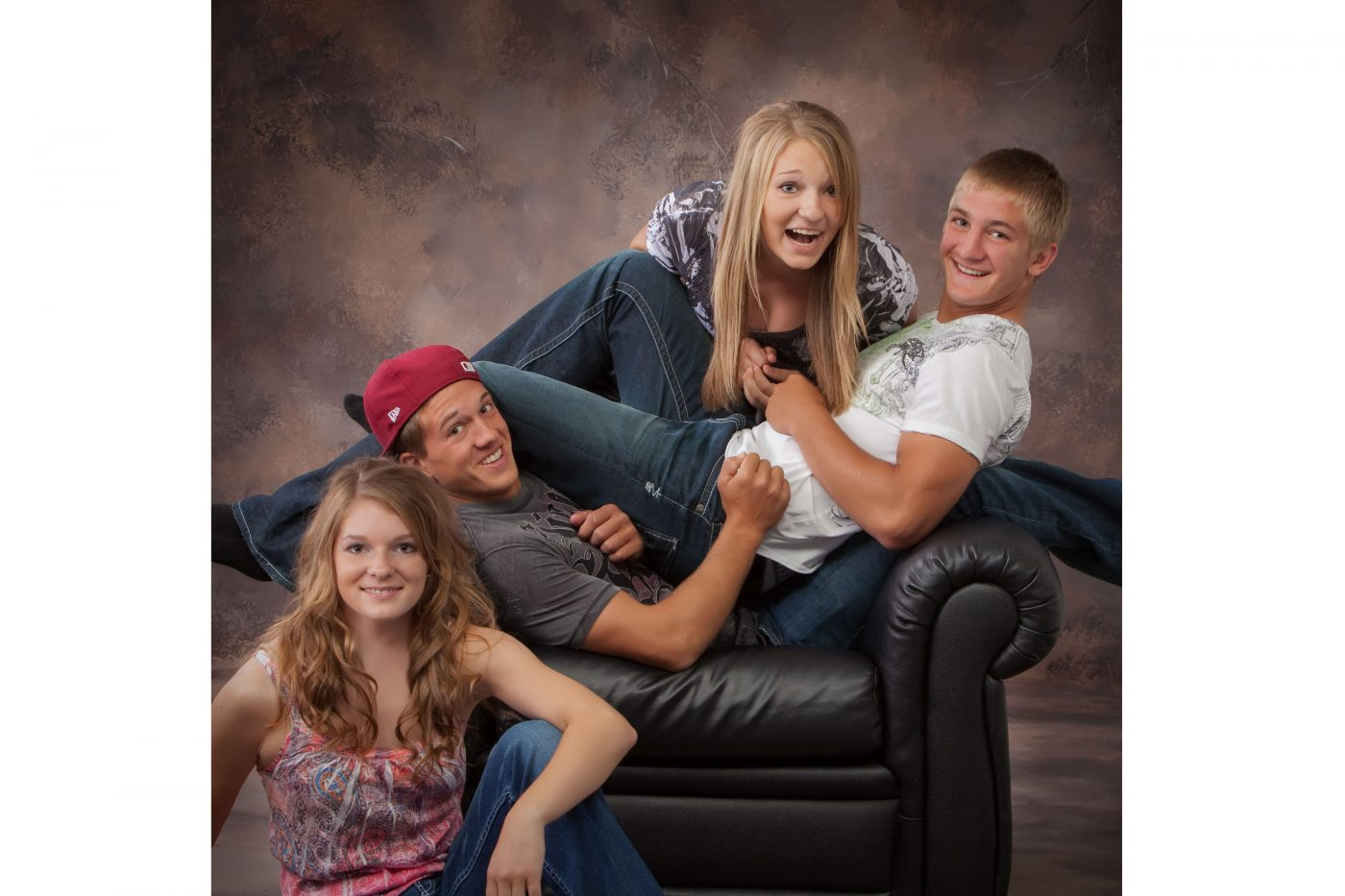 A casual, contemporary modern, arrangement of a family of 4 siblings.