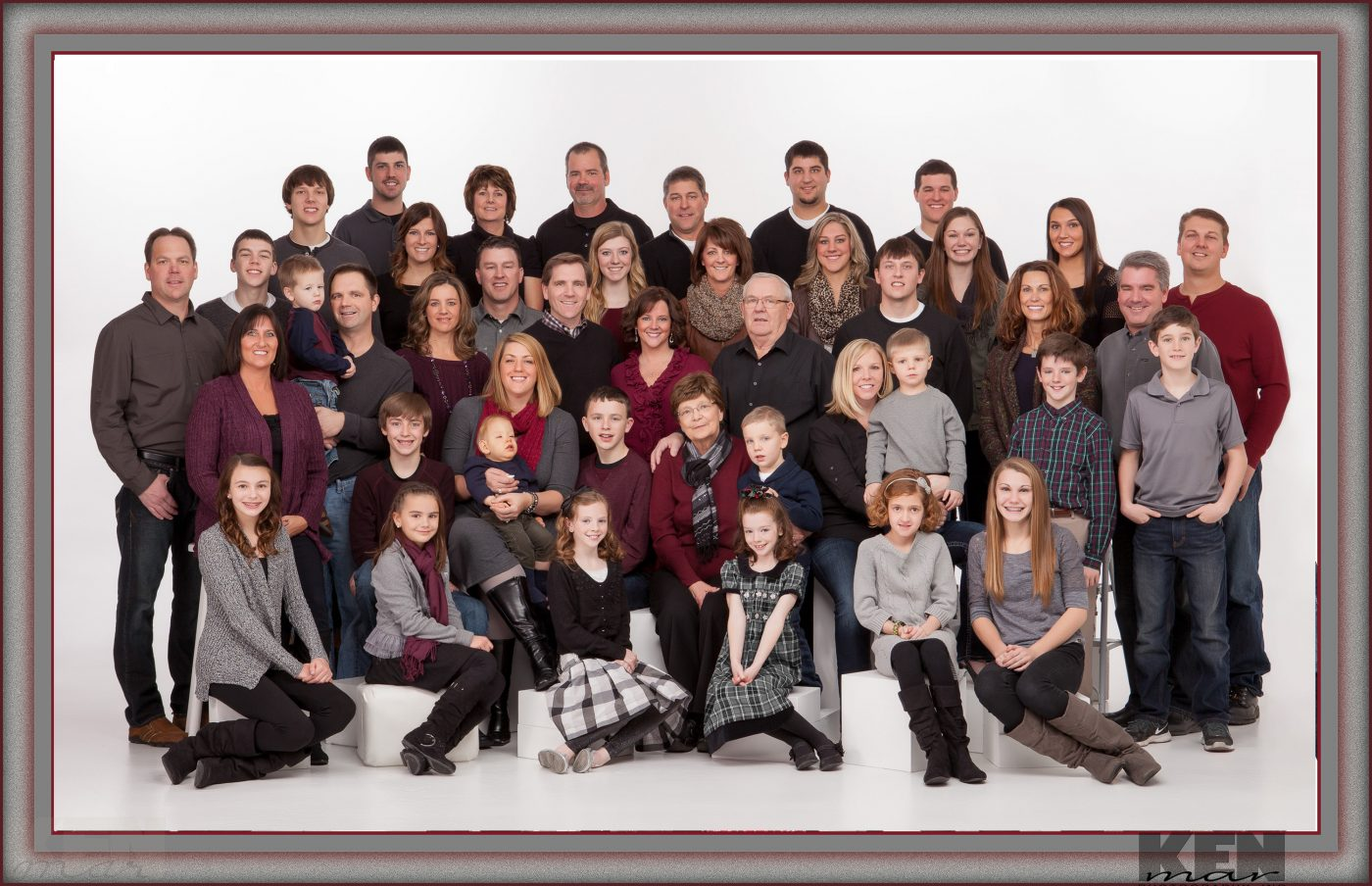 Fourty (40) people comfortably posed for a family grouping in the studio.