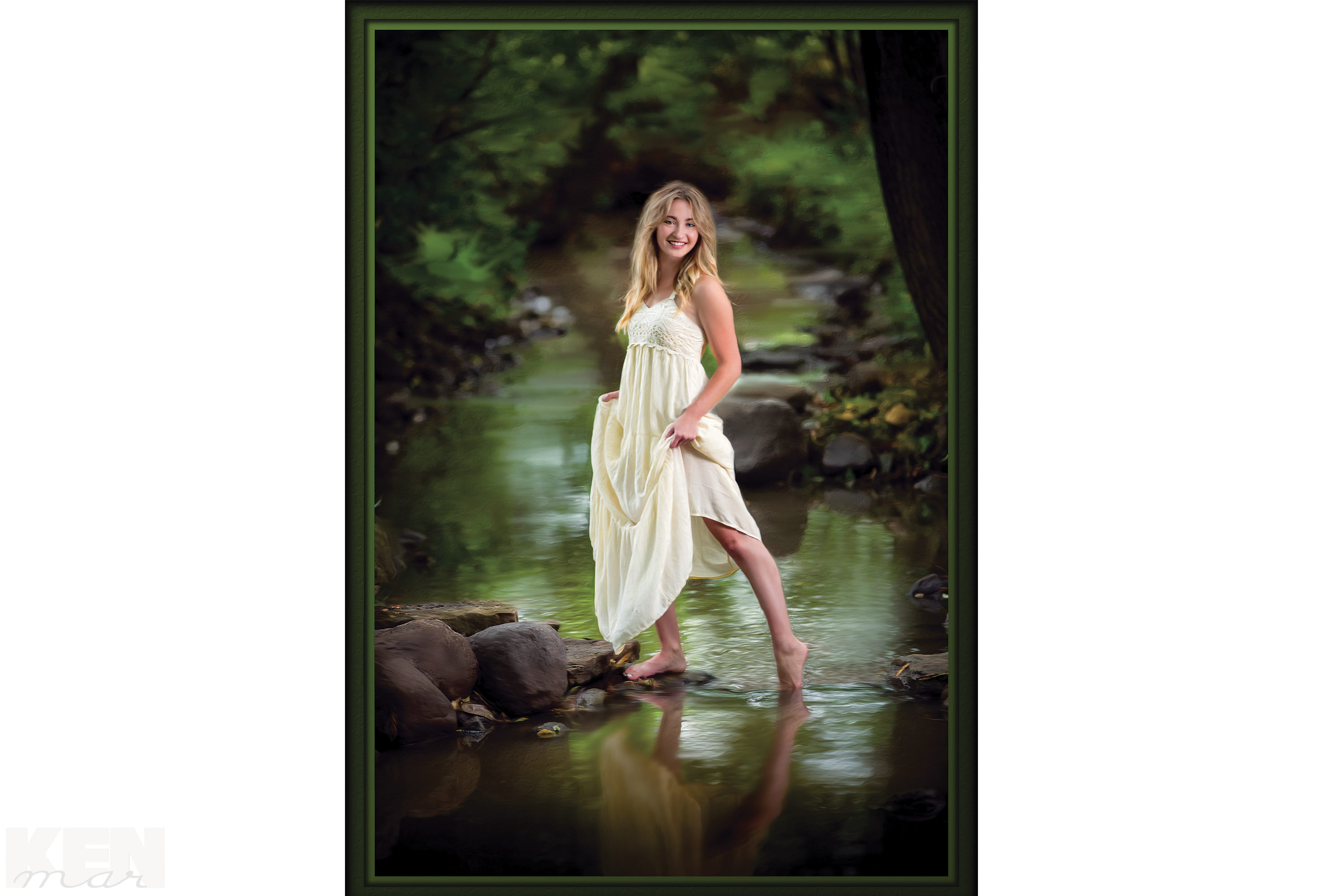 Young woman posed outdoors by stream KenMar / 1120 North Hickory Farm Lane / Appleton, WI 54914 / 920-734-5328