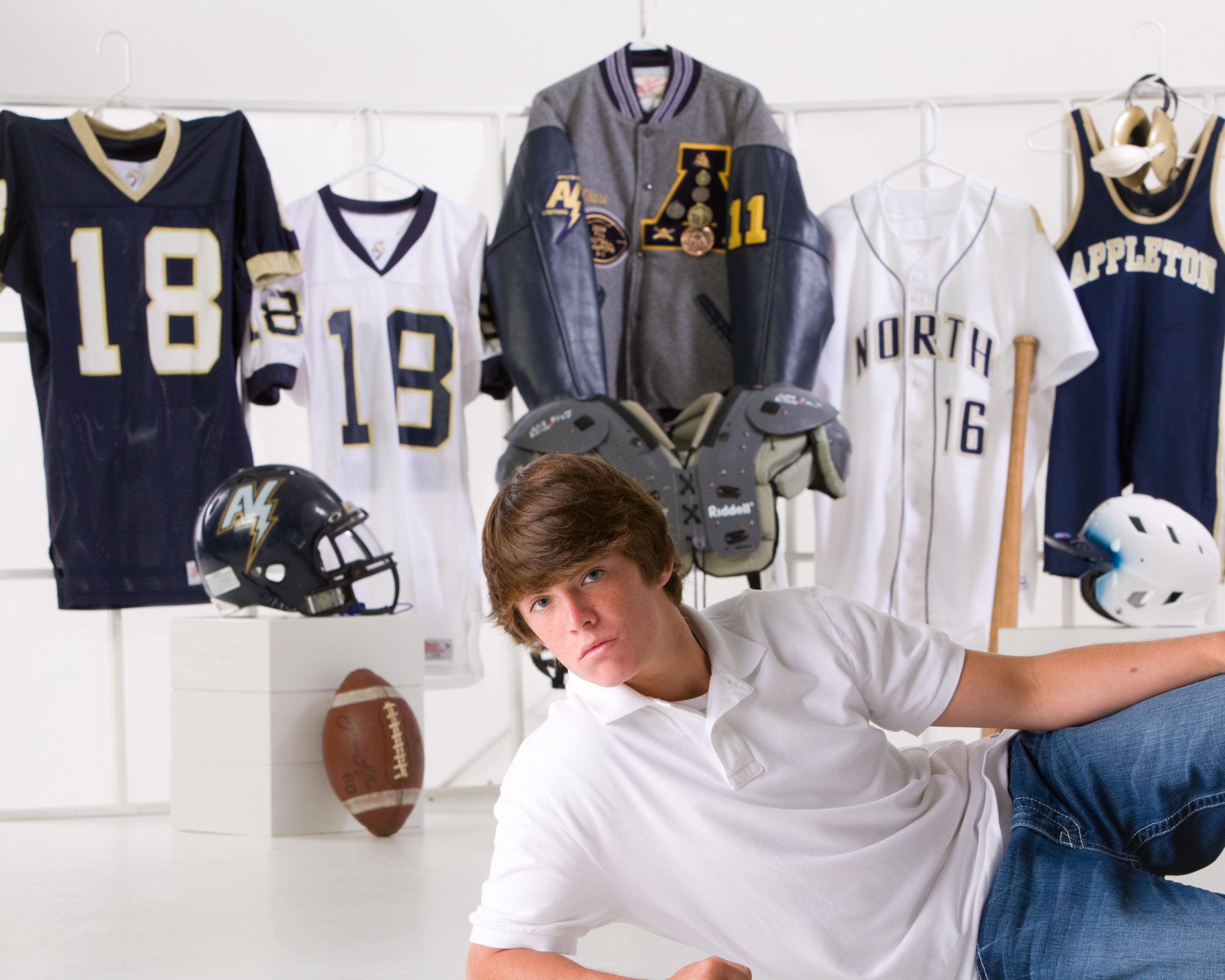 High school senior boy with sports stuff