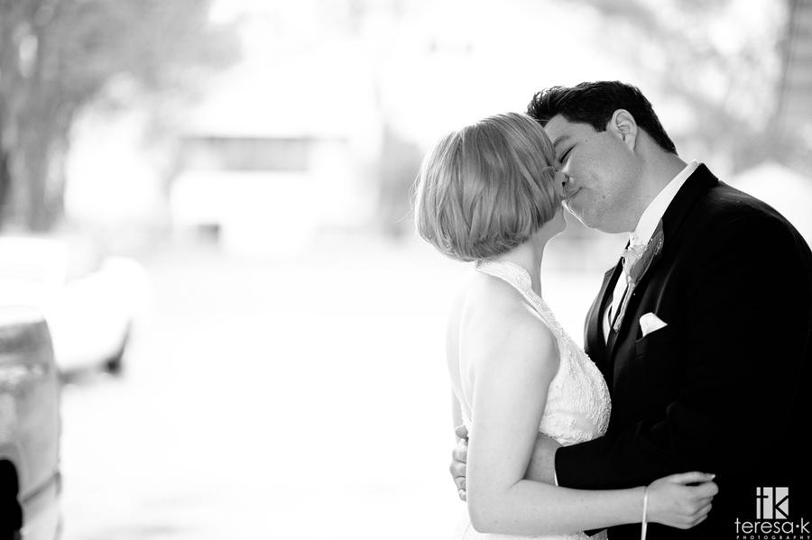 bride and groom sharing a passionate kiss