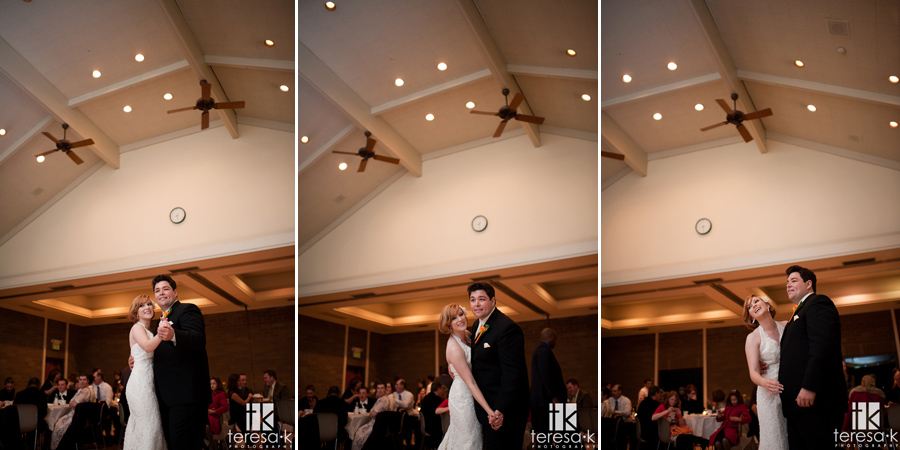 bride and groom dancing and twirling in open reception area