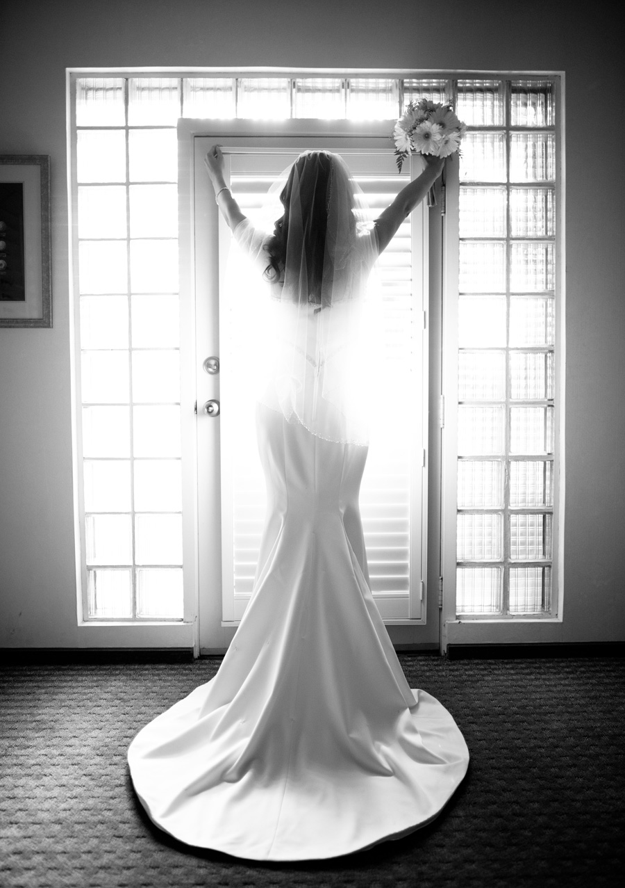 beautiful backlit picture of brides dress by a window