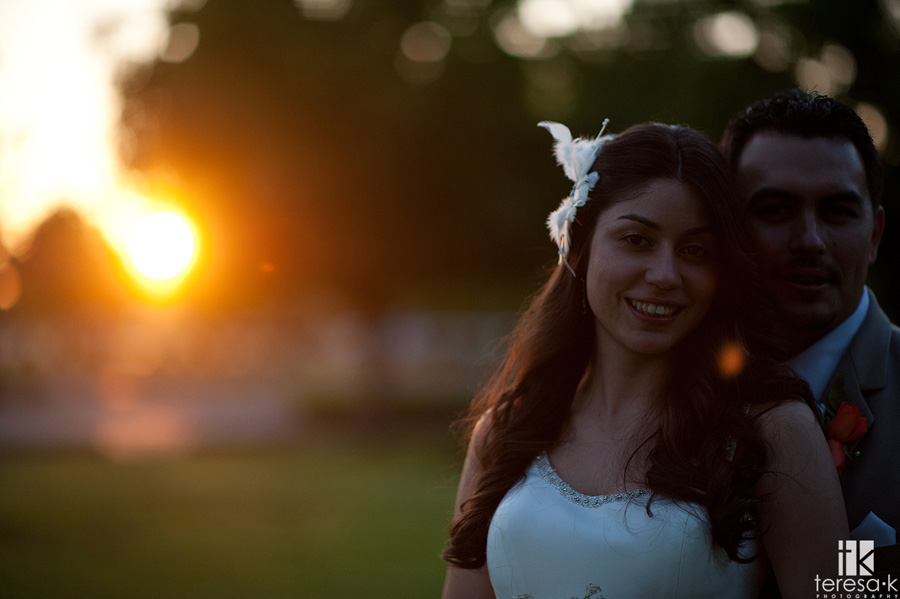 strongly backlit photograph of bride and groom at McClellan afb wedding