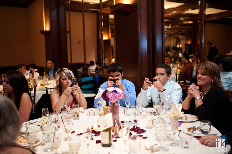 kids texting at wedding reception