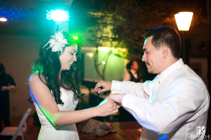 bride and groom dancing away the nigh