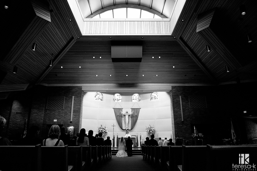 wide shot of wedding at st john the Baptist church in Folsom