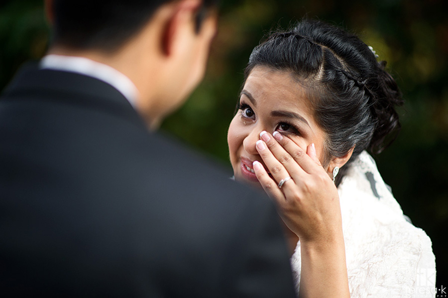 bride wipes tear at Oakland wedding first look