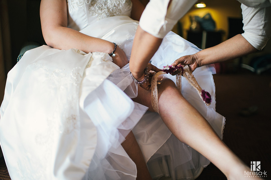 putting on the garter for the wedding
